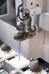 Impeller grinding machine at work