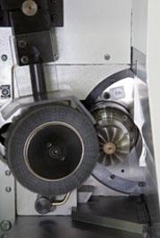 Impeller grinding machine at work